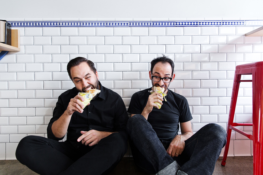 Cofax manager Adam Flamebaum and co-founder Jason Bernstein take a burrito break.