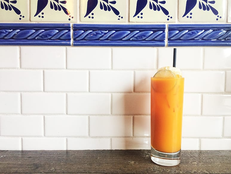 Mezcal perfectly complements fresh carrot juice and ginger in this brunch cocktail from NIDO, called the Orange Maria. | Photo by Emma Janzen.