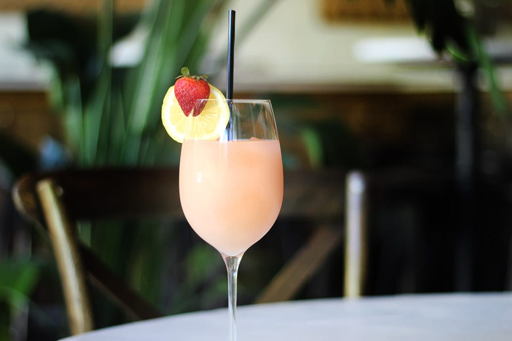 With strawberry and coconut water, the Coconut Frosé from Baci e Vendetta is downright heavenly. | Photo by Hannah Schneider.