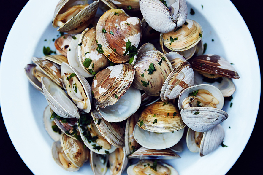 Grilled Clams with Wine Bottle Sauce. | Photo by William Hereford.