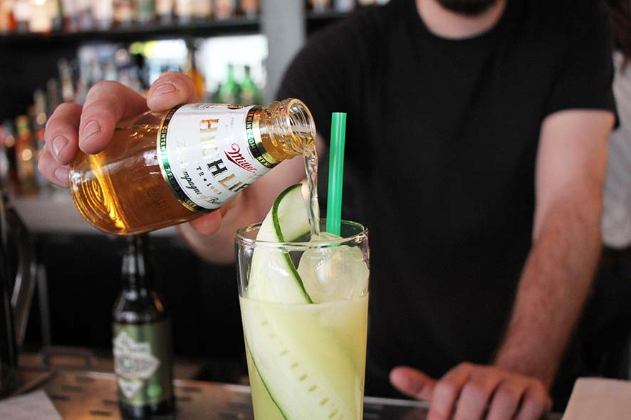 Mezcal, tequila, lime, honey, and ginger round out this Misunderstood Beer Cocktail. | Photo by Emma Janzen.