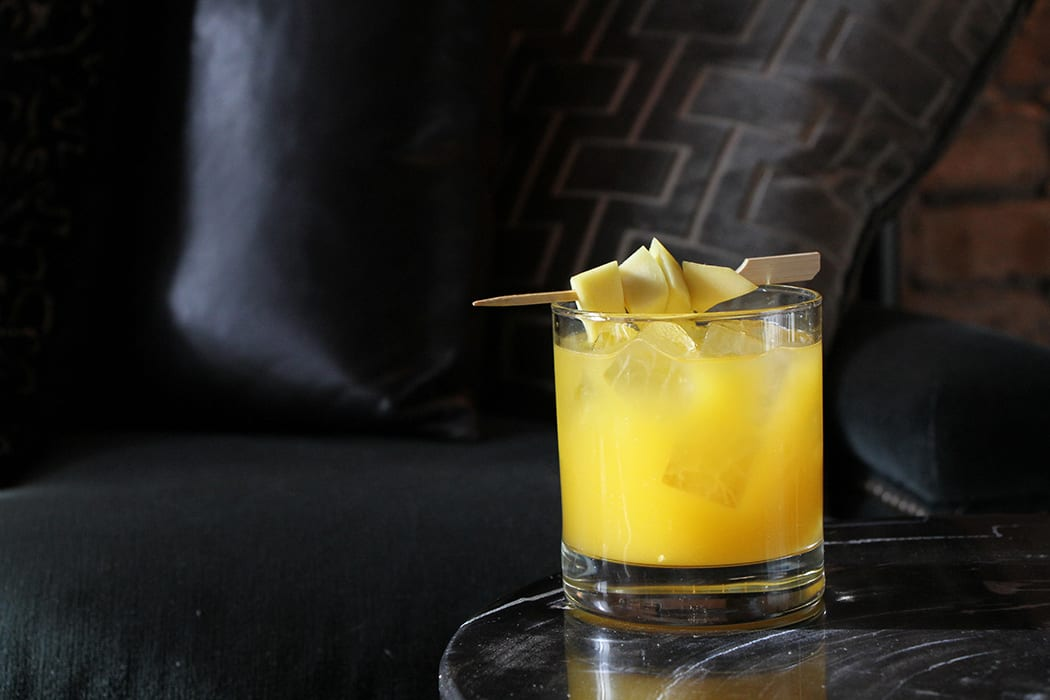 Mango and coconut water collide in the Pisco Punch revamp from Presidio in Chicago. | Photo by Emma Janzen.