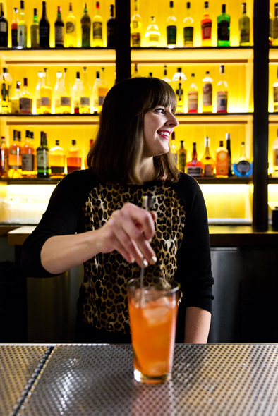 Mary Bartlett behind the bar at Honeycut.