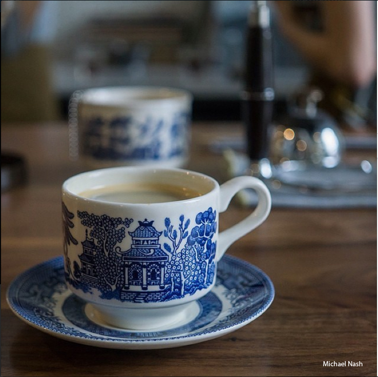 Drinks and pastries are served in blue Willow cups and dishes. | Photo by Michael Nash