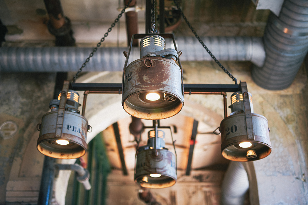 Old kerosene containers were salvaged from the Pearl compound to create this industrial-chic chandelier.