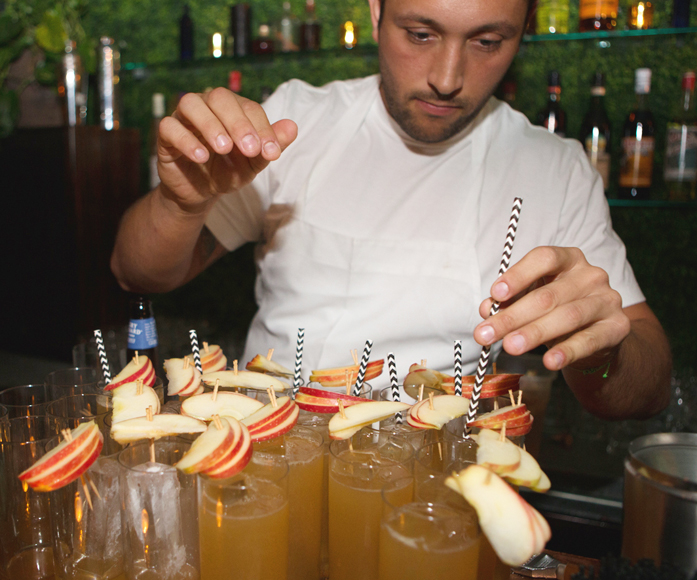 Brandyn Tepper prepping cocktails at Apartment A.