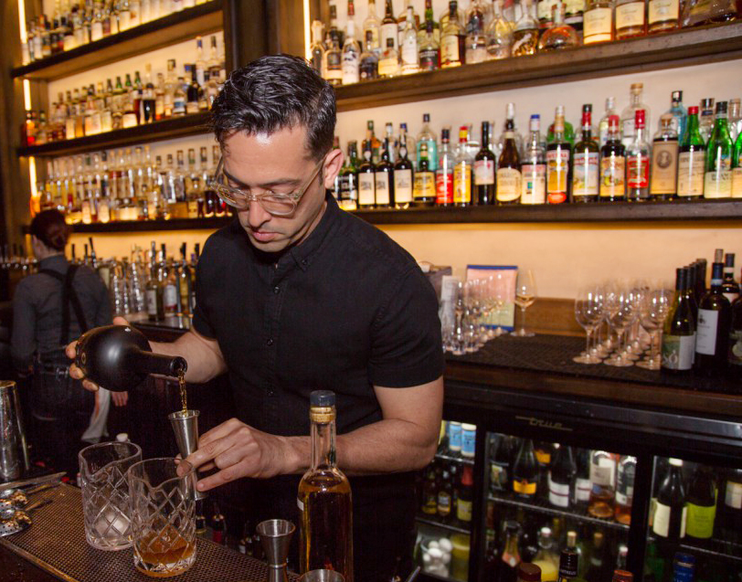 Scopa Italian Roots' Pablo Moix mixes a round of drinks.