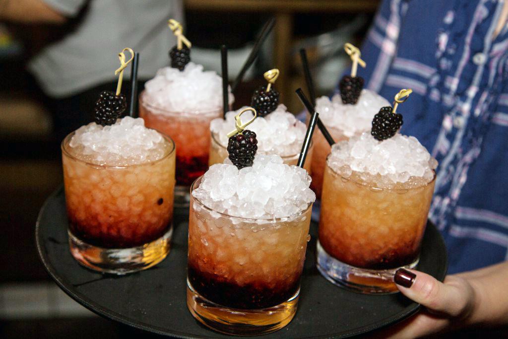 The Cognac Fix with Courvoisier VS, blackberries, lemon and sugar.