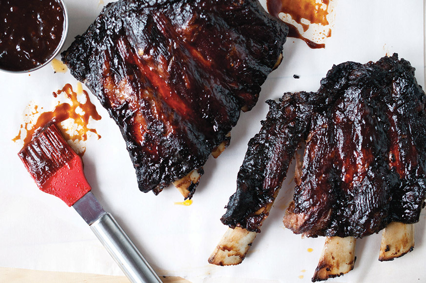 Beer-spiked barbecue sauce lends some finger-licking goodness to these slow-roasted Maple Stout Baby Back Ribs. | Photo by Jacquelyn Dodd.