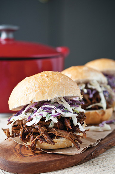 Porter-marinated pulled pork and IPA-glazed slaw make these Porter-Braised Pulled Pork Sandwiches a double hit of hops and malty goodness. | Photo by Jacquelyn Dodd.