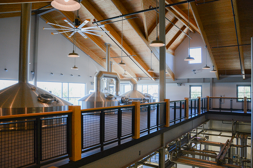 The building was designed with brew tours in mind. The second floor catwalk gives guests a bird's eye view of the operations below while staying a safe distance from the action.