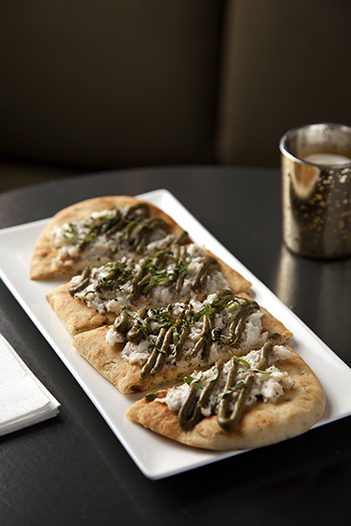 The bar menu features a number of flatbreads, perfect for late-night snacking.
