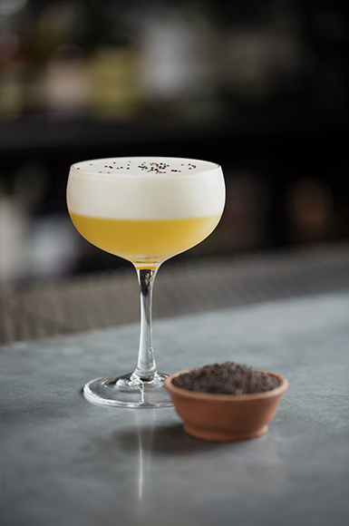 Drinks on the menu at Mace take inspiration from spices, like the Mustard Seed cocktail, with combines mustard seed–infused Suze, banana liqueur, lemon juice and egg white. | Photo by Scott Gordon Bleicher.