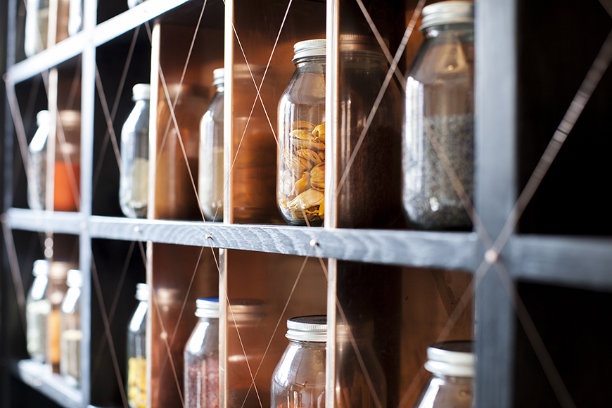 Jars of spices sourced from Greg Boehm's world travels decorate the back bar.