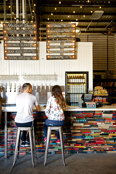 3,000-odd books were used to build the colorful taproom bar.