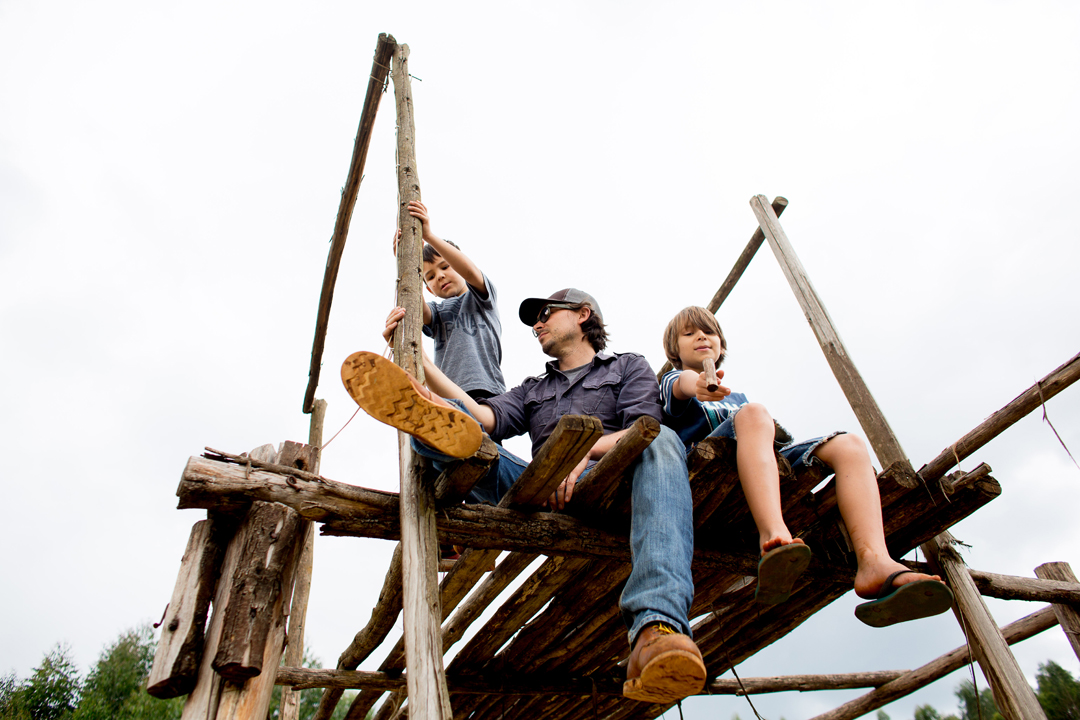 Ben Carlson and his sons check out harvest from the security tower at their washing station in Bukeye, Burundi.