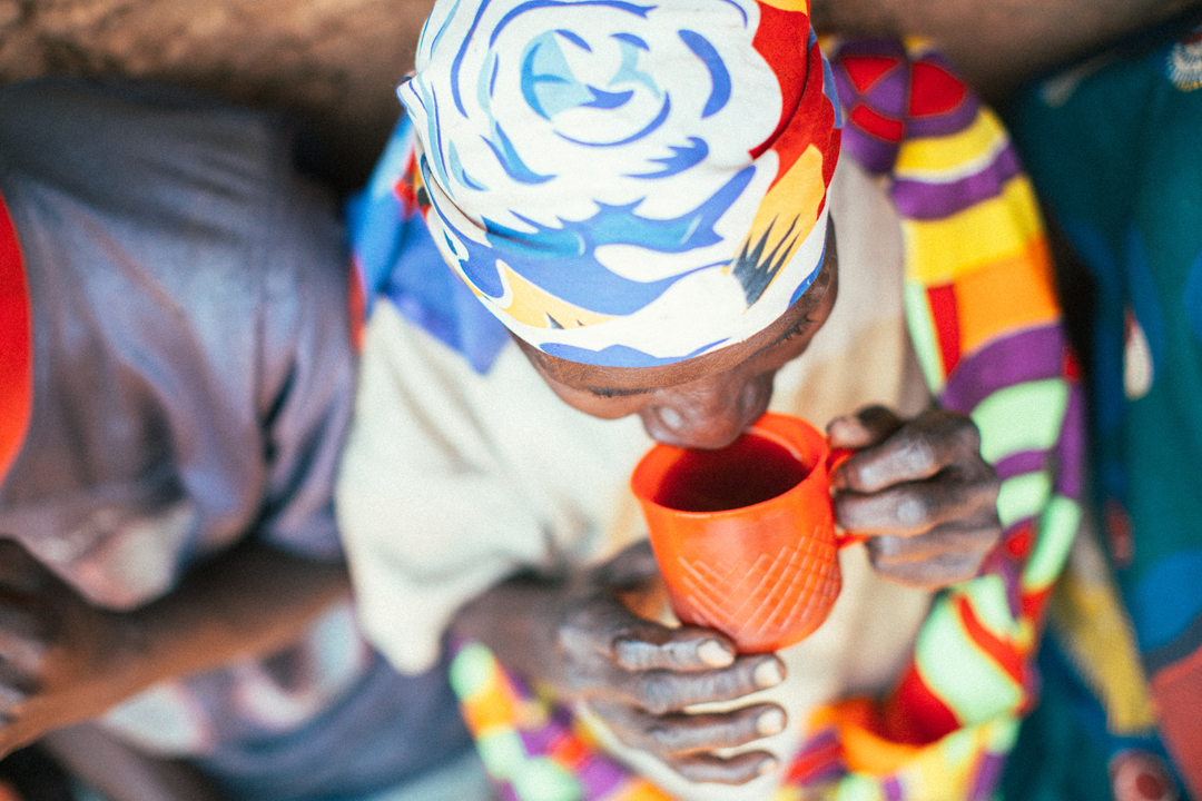 On Gaharo hill, coffee farmers get a chance to drink the coffee from their hill while they chat with the Carlsons about current challenges and opportunities. Most of them had never tasted their own coffee before the Carlsons started brewing it up during these community meetings.