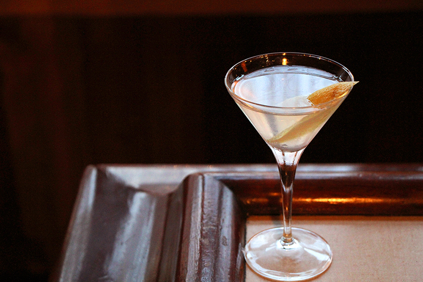 The house Martini showcases navy-strength gin, Noilly Prat dry vermouth and orange bitters.  Photo by Emma Janzen.