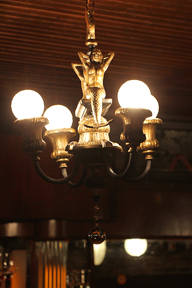 No maritime bar would be complete without a mermaid light fixture. Photo by Emma Janzen.