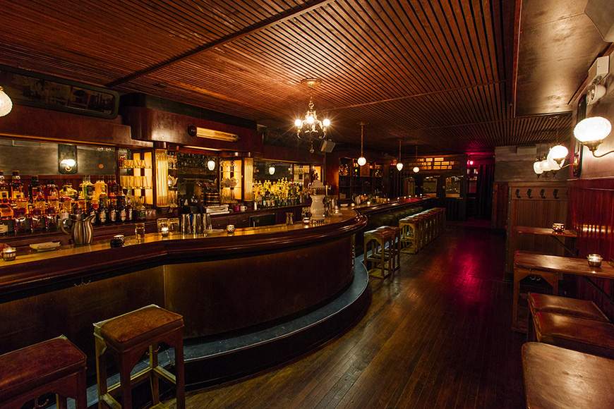 Many original features of the interiors, including  the long galley bar, wood flooring and mahogany backbar were preserved as a nod to the bar's history. Photo by Nick Murway.