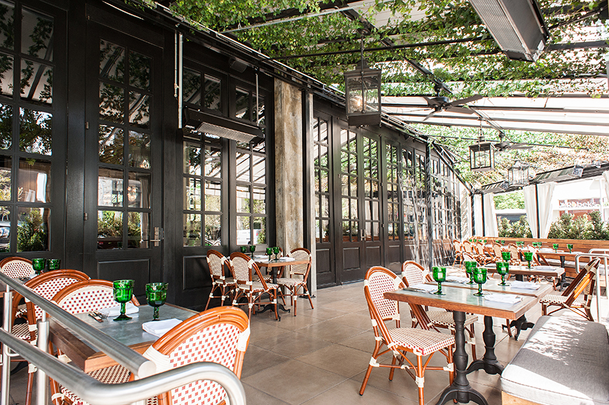 The outside patio offers an oasis for cocktail sipping at Faith & Flower. | Photo by Wonho Frank Lee