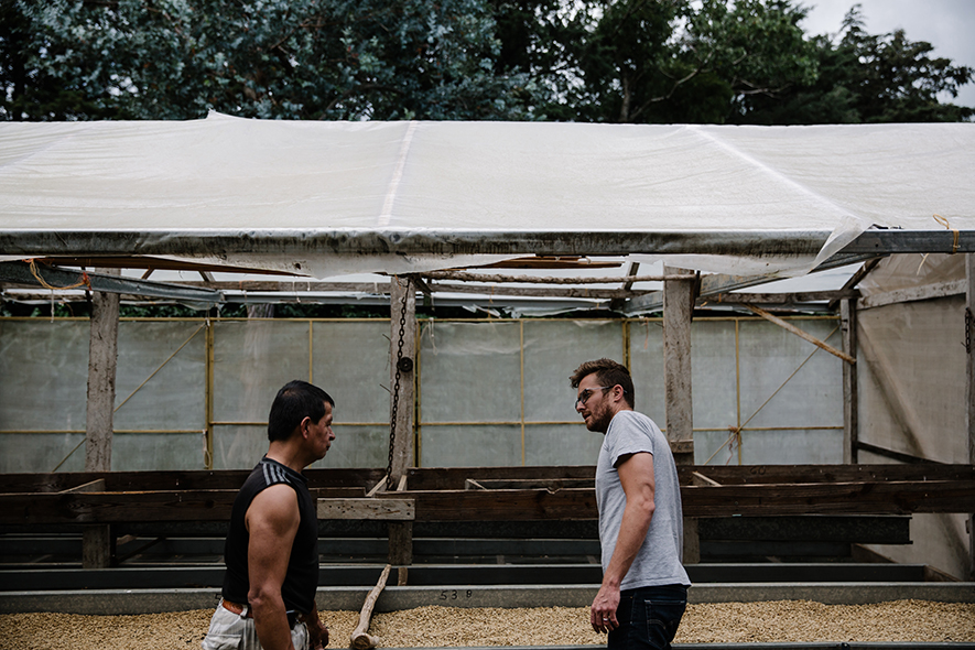Tito Vargas shows Ludwikowski  around his custom-built solar dryers as he explains his drying process. Like many farmers, he's incredibly passionate about his work. When Ludwikowski  asked him if he was married, he replied,