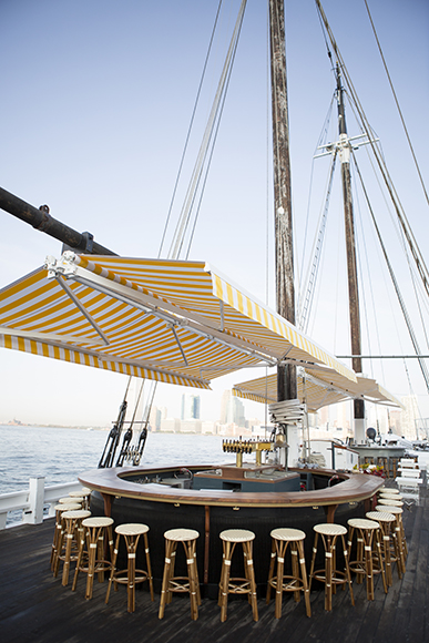 Architects restored a historic schooner to create Grand Banks, a one-of-a-kind floating oyster and cocktail bar. | Photo by Doug Lyle Thompson