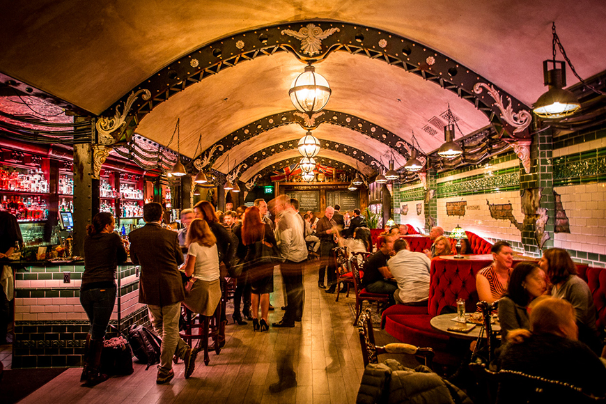 Marked by a spectacular barrel-vaulted ceiling and weathered subway tiles, the main bar (known as The Platform room) speaks to the aesthetics of an abandoned London tube station.