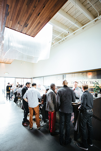 The bar area is a hub of activity in the large, airy space.