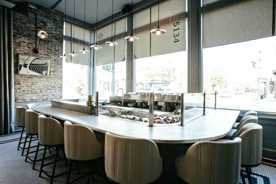 If you're not sitting at the cocktail bar, stools at the raw bar are the next most coveted seats in the house.