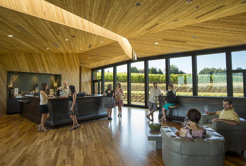 Inside the tasting room, floor-to-ceiling windows allow natural light to fill the room and provide stunning views.