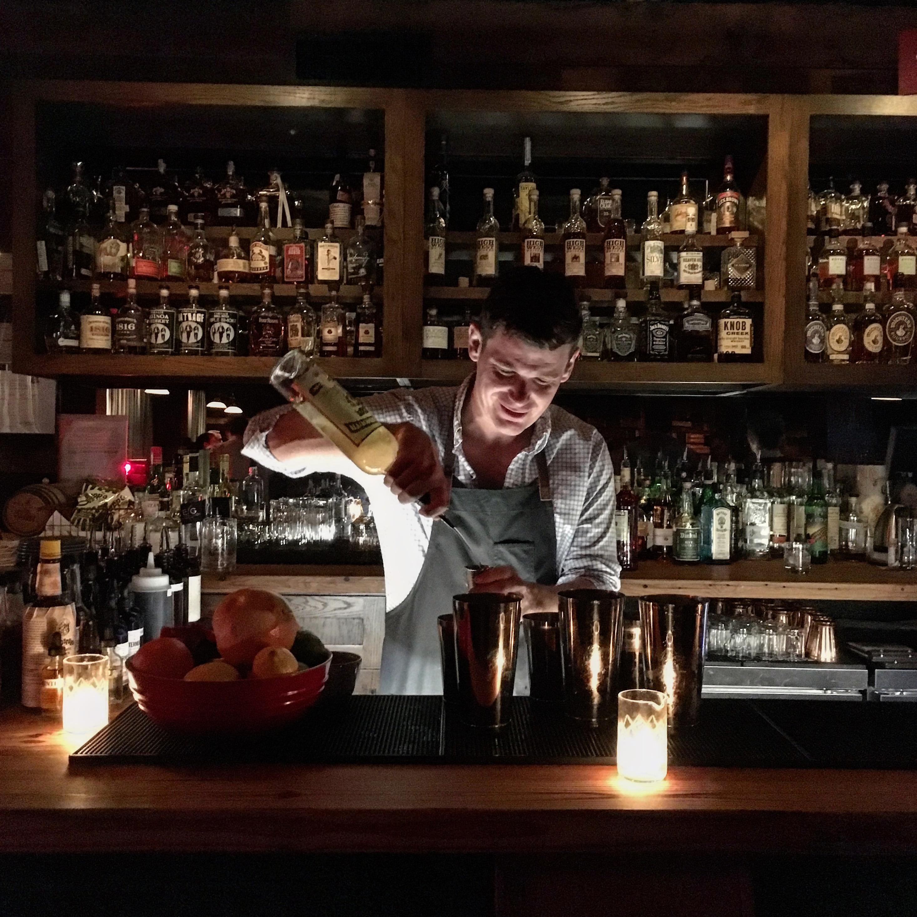 Teddy Nixon mixing up cocktails at Bar Mash.