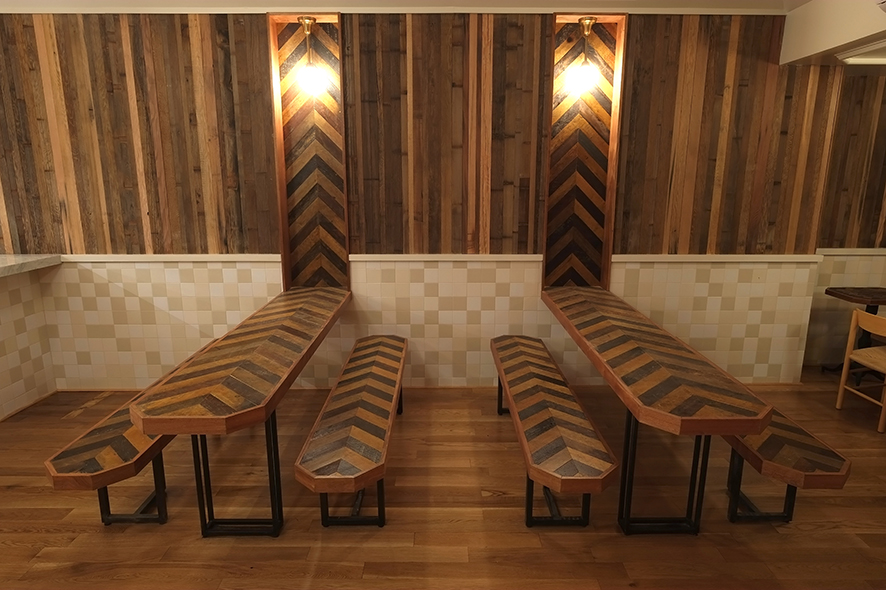 An interplay of reclaimed wood keeps Torst feeling warm and inviting.