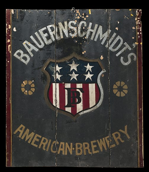 "This painted ""American Brewery"" sign features a patriotic shield with the initials ""FB"" (for the brewery's owner, Frederick Bauernschmidt). From the Voigt collection, circa 1899-1919."