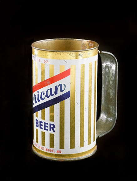 This striking American beer can with handle was produced by American Brewery, Inc., one of the largest, post-Prohibition breweries in Baltimore, Maryland. From the Voigt collection , circa 1933-1950.