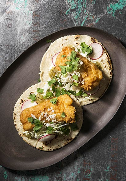 You can't go wrong with the crispy fish featured in these Beer-Battered Fish Tacos. | Photo by Evan Sung.