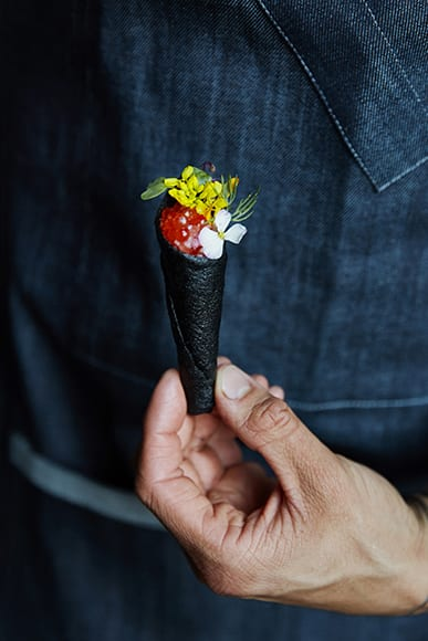 The bar snacks are elevated and whimsical, like this Gravalax Cone with roe, trout, dill and goat cheese.