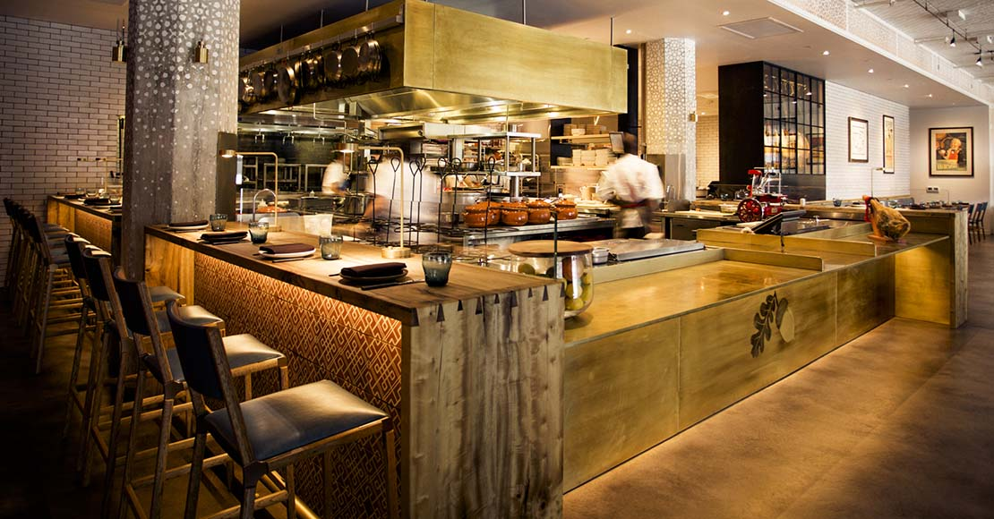 An open kitchen brings the action to diners in the main space at Bellota.