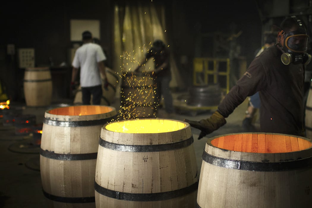 Toasting the barrels is one of the most important steps in the process in terms of its influence on the final flavor of the wine. Pictured here: Barrels being toasted at Demptos Napa Cooperage, where Caldwell sourced their barrels before starting their own cooperage.