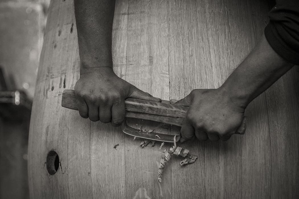 Though much of the coopering process is machine-assisted these days, Herrera still frequently uses his original hand tools, like this hand planer.