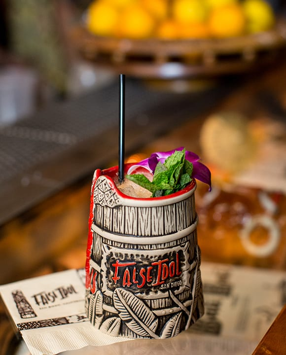 All of the cocktails at the bar are served in custom-made tiki mugs. | Photo by Arlene Ibarra.