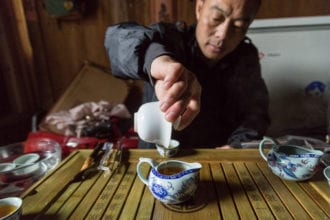 Filtering the tea from the gaiwan (bowl and lid) into the chahai (tea pitcher). From the tea pitcher, the tea is distributed into the individual chawan (tea bowl) to be enjoyed.