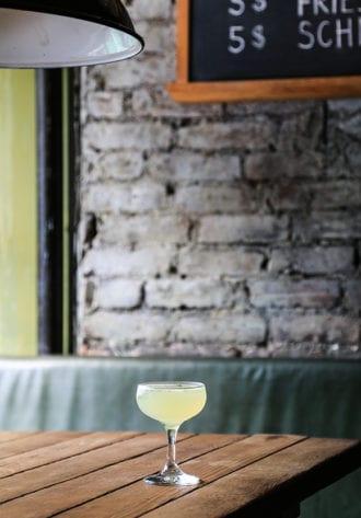 third man-woman in gold cocktail-vertical-crdt-katie-burton
