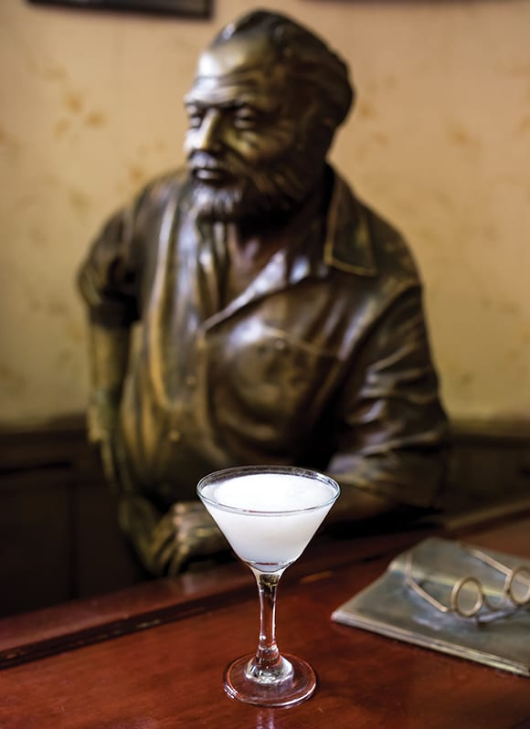 A life-size statue of Ernest Hemingway oversees the bar at El Floridita.