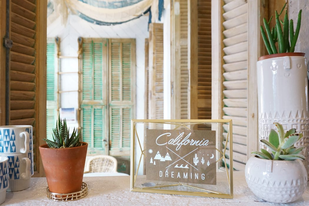 Heather Tierney's design company Wanderlust added feminine touches throughout the space to evoke the cool vibes of California. | Photo by Whitney Leigh Morris.