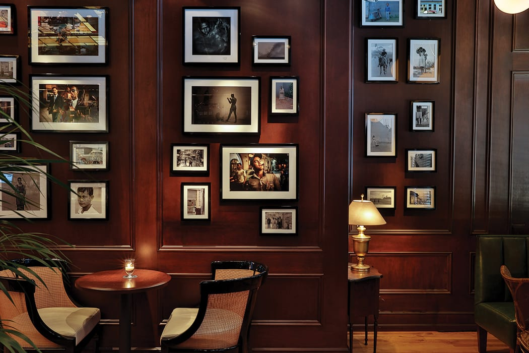 Hundreds of photos from famed photographer Vern Evans line the walls.