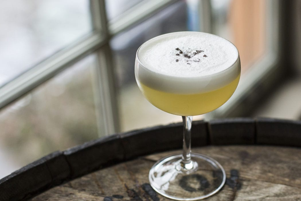 The Aviary, with Bourbon, lemon, mezcal, egg white, cane. Raven & Rose and The Rookery Bar, in downtown Portland, Oregon.
