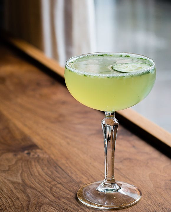 Analogue's take on the Southside (called The West 8th) brings cucumber and vodka to the requisite mix of mint, lemon and syrup. | Photo by Asia Coladner.