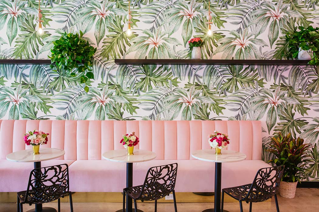 A bright pink custom-designed banquette anchors the cafe.