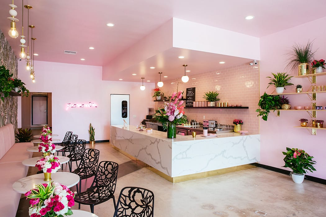 Holy Matcha's vibrant interior features a bold pallette of pink, green, white and black.